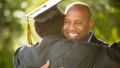 Graduate success - celebrating her father - iQ Academy